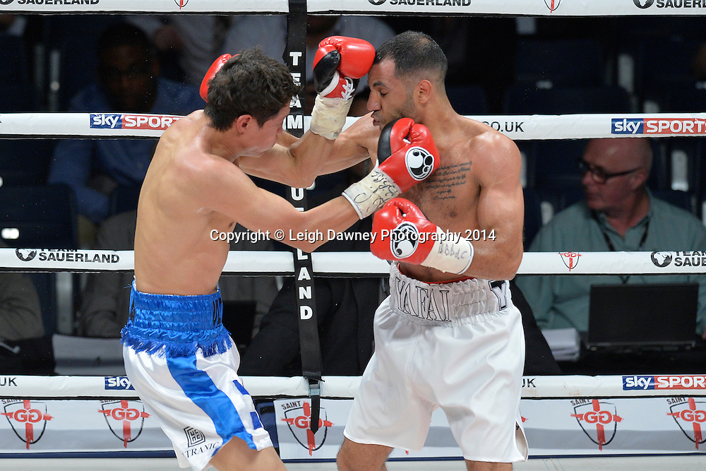 Khalid Yafai (white shorts) defeats Herald Molina to claim the vacant IBF Inter Continental Super Flyweight Title at the SSE Wembley Arena, London on the 20th September 2014. Sauerland Promotions. Credit: Leigh Dawney Photography.