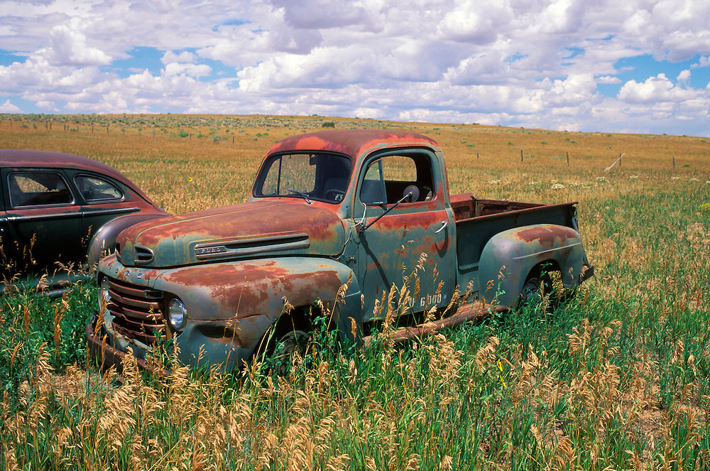1930's era Ford pick-up truck, abandoned in a farmer's field.  Along historic Route 66, Utah, USA
