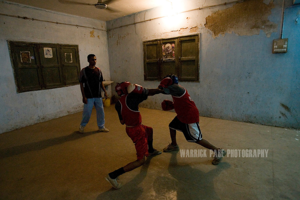 KARACHI, PAKISTAN - OCTOBER 12: Members of the Young Baloch Boxing Club spar during training, Sunday, October 12, 2008, in Karachi, Pakistan. Lyari is Karachi's poorest, most dangerous, drug and crime-infested slum, but has produced the bulk of Pakistan's champion boxers. Boxing has been a way of survival for many of the young men, who are often sponsored by corporations and event the military, to box for them at events throughout the city and the country. Lacking in the most basic resources, including a sufficient diet, the young boxers have watched countless champions on television throughout the years, attempting to emulate their abilities. (Photo by Warrick Page)