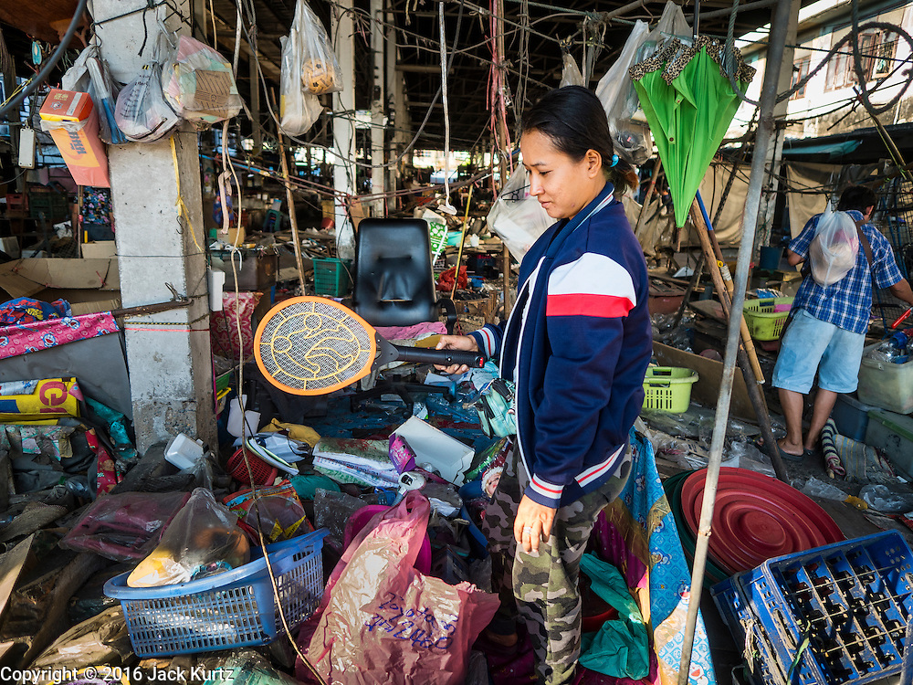 05 JANUARY 2016 - BANGKOK, THAILAND:          A woman walks through the closed Bang Chak Market looking for anything that can be saved or recycled. The market closed permanently on January 4, 2016. The Bang Chak Market served the community around Sois 91-97 on Sukhumvit Road in the Bangkok suburbs. Bangkok city authorities put up notices in late November that the market would be closed by January 1, 2016 and redevelopment would start shortly after that. Market vendors said condominiums are being built on the land.                   PHOTO BY JACK KURTZ