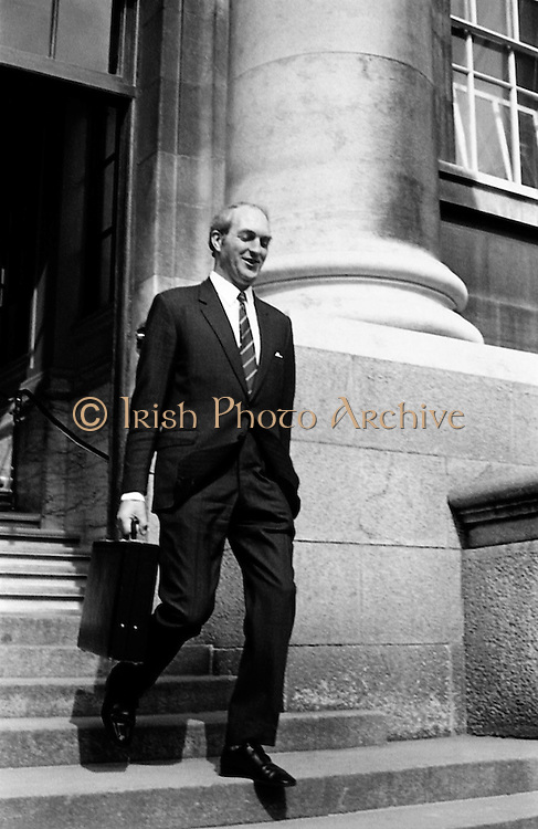 Minister for Finance, George Colley, leaving the department of Finance on his way to Dail Eireann to deliver his Budget speech.<br /> <br /> 19/04/1972