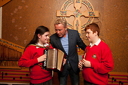 Repro Free: 18/10/2012 Paul Geoghegan (12) from Tallaght and Jasmine Boyle (12) from Finglas both pupils of ChildVision, the national education centre for blind children, pictured with Michael Flatley as he launches a unique album of traditional Irish music featuring music made famous by blind musicians and now played by a new generation of sightless players at Woodlock Hall, All Hallows College, Drumcondra. The brainchild of Catherine McGorman the venture was supported by the Arts Council and all funds raised will go to supporting music teaching for blind and partially sighted children at ChildVision, the national education centre for blind children. Pic Andres Poveda