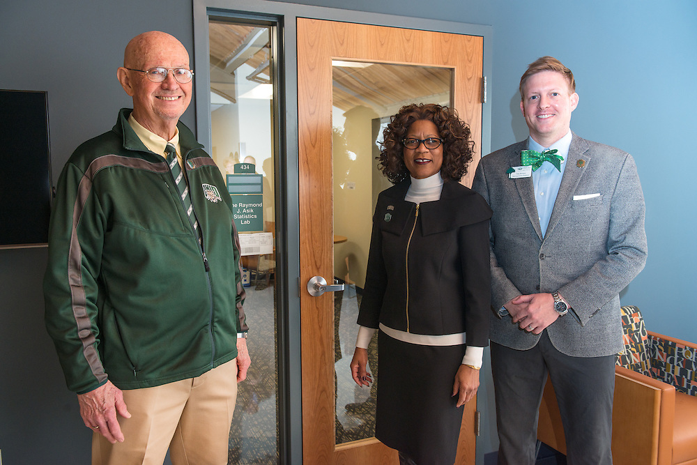 Donor Raymond Asik, left, Dean Renee Middleton and Tim Binegar, Director of Development, stand beside the new statistics lab just prior to the ribbon cutting ceremony for the Gladys W. and David H. Patton College of Education's newly renovated McCracken Hall on January 27, 2017.