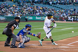 OAKLAND, CA - JULY 15:  Khris Davis #2 of the Oakland Athletics hits an RBI single in front of Russell Martin #55 of the Toronto Blue Jays and umpire Mark Wegner #14 during the first inning at the Oakland Coliseum on July 15, 2016 in Oakland, California. (Photo by Jason O. Watson/Getty Images) *** Local Caption *** Khris Davis; Russell Martin; Mark Wegner