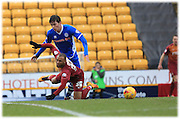 Niall Canavan fouls Wes Thomas during the Sky Bet League 1 match between Bradford City and Rochdale at the Coral Windows Stadium, Bradford, England on 20 February 2016. Photo by Daniel Youngs.