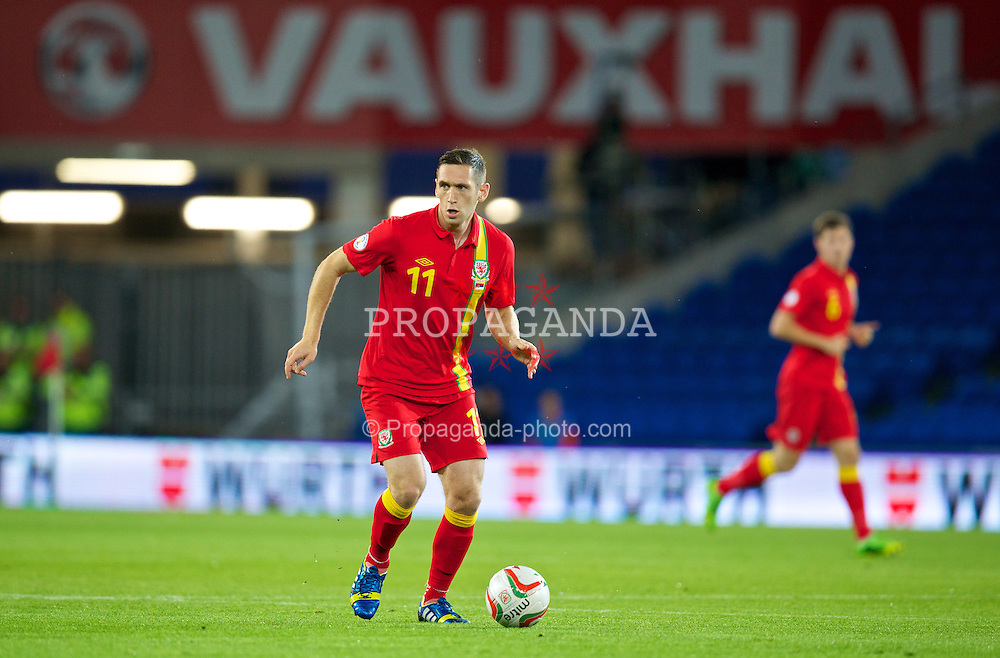CARDIFF, WALES - Tuesday, September 10, 2013: Wales' Andrew Crofts in action against Serbia during the 2014 FIFA World Cup Brazil Qualifying Group A match at the Cardiff CIty Stadium. (Pic by David Rawcliffe/Propaganda)