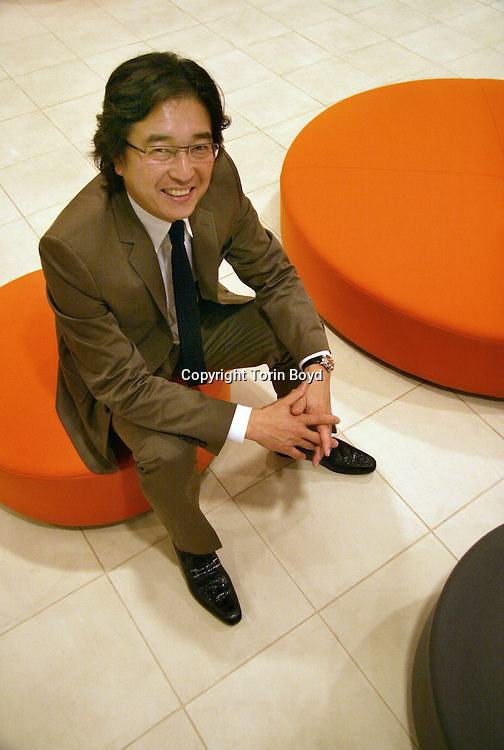This is a photo of Mr. Fumio Takashima, the President and CEO of BALS Corporation which is a leading Japanese company of interior design retail stores. Mr. Takashima is seen here in the lobby of his corporate office in the Shibuya district of Tokyo. BALS owns and operates over 90 retail store in Japan and overseas which include; Franc Franc, Agito, BALS Tokyo, Herve Gambs, J. (pronounced Jay Period) and Koufourou..