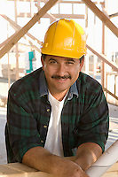 Portrait of man at construction site in hardhat