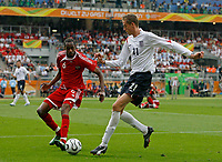 Photo: Glyn Thomas.<br />England v Trinidad & Tobago. Group B, FIFA World Cup 2006. 15/06/2006.<br /> England's Peter Crouch (R) and Trinidad & Tobago's Dennis Lawrence.