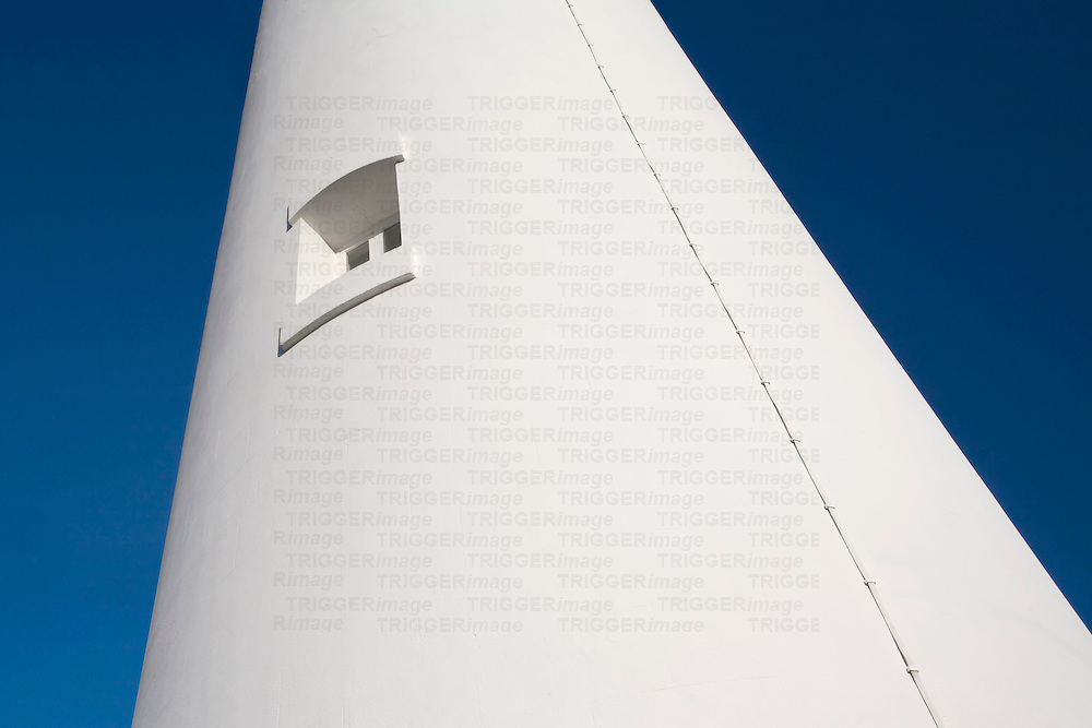 Alternative view of a light house at Hurst Point creating a stricking blue and white image.