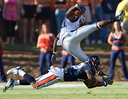 Virginia safety Byron Glaspy (22) tackles Connecticut wide receiver Terence Jeffers (80). ..The Virginia Cavaliers defeated the Connecticut Huskies 17-16 at Scott Stadium in Charlottesville, VA on October 13, 2007
