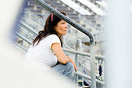 An evacuee sits alone on the highest level of seats at Qualcomm stadium.