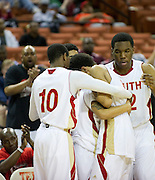 South Grand Prairie players hug senior Trey Hall (4) as he leaves the game against Fort Bend Travis during the UIL 5A state championship game at the Frank Erwin Center in Austin on Saturday, March 9, 2013. (Cooper Neill/The Dallas Morning News)