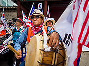 09 JUNE 2018 - SEOUL, SOUTH KOREA: A man plays a drum during a pro-American rally in downtown Seoul. Participants said they wanted to thank the US for supporting South Korea and they hope the US will continue to support South Korea. Many were also opposed to ongoing negotiations with North Korea because they don't think Kim Jong-un can be trusted to denuclearize or to not attack South Korea.    PHOTO BY JACK KURTZ