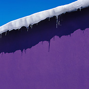 A winter abstract - purple wall overlaying at blue sky<br />