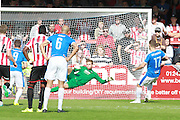 Nicky Deverdics scores from the centre spot during the Vanarama National League match between Cheltenham Town and Dover Athletic at Whaddon Road, Cheltenham, England on 12 September 2015. Photo by Antony Thompson.