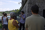 Una guida volontaria della Pro Loco di Trezzo che accompagna i visitatori durante le vsite guidate, che si effettuano tutte le prime domeniche del mese nella centrale idroelettrica Taccani...A tour guide accompanies a tourist group to visit the hydroelectric plant Taccani, in the first sunday of the month that the central is open.