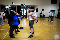 © Licensed to London News Pictures. 03/03/2019. Dorking, UK. Competitors being interviewed by media as they prepare to take part in the 2019 annual Wife Carrying Race in Dorking, Surrey. Run over a course of 380m, with both men and women carry a 'wife' over obstacles, the race is believed to have originated in the UK over twelve centuries ago when Viking raiders rampaged into the northeast coast of England carrying off any unwilling local women . Photo credit: Ben Cawthra/LNP