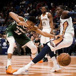 Mar 12, 2019; New Orleans, LA, USA; Milwaukee Bucks forward Giannis Antetokounmpo (34) draws a foul on a collision with New Orleans Pelicans forward Cheick Diallo (13) during the second half at the Smoothie King Center. Mandatory Credit: Derick E. Hingle-USA TODAY Sports