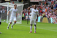 Swansea city's Wayne Routledge (r) celebrates after he scores his sides 1st goal. Barclays Premier league, Swansea city v Sunderland at the Liberty Stadium in Swansea, South Wales on Saturday 1st Sept 2012. pic by Andrew Orchard, Andrew Orchard sports photography,
