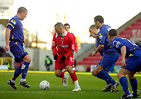 Photo: Alan Crowhurst.<br />Swindon Town v Morecambe. The FA Cup. 02/12/2006.<br />Swindon's Christian Roberts (C) is surrounded by Morecambe players.