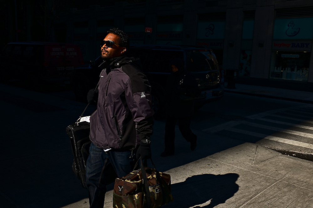 Man carrying luggage, New York, NY, US