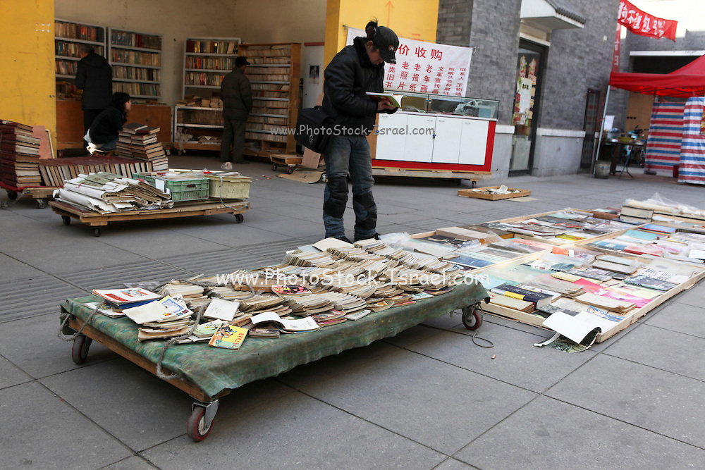China, Beijing, Busy pedestrian street market Used Book stall