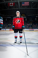 KELOWNA, CANADA - JANUARY 17: Cal Foote #25 of the Kelowna Rockets stands at centre ice for the starting line up against the Lethbridge Hurricanes wearing his Team Canada World Jr. Championship jersey on January 17, 2017 at Prospera Place in Kelowna, British Columbia, Canada.  (Photo by Marissa Baecker/Shoot the Breeze)  *** Local Caption ***