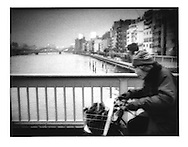 Cycling across Sumida River Bridge in Ueno, Tokyo, Japan.
