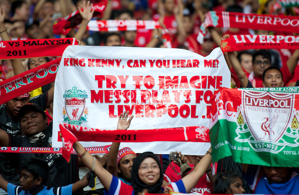 KUALA LUMPUR, MALAYSIA - Saturday, July 16, 2011: Liverpool supporters during a match against a Malaysia XI at the National Stadium Bukit Jalil in Kuala Lumpur on day six of the club's Asia Tour. (Photo by David Rawcliffe/Propaganda)