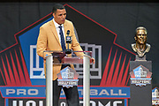 Aug 3, 2019; Canton, OH, USA; Tony Gonzalez speaks during the Pro Football Hall of Fame Enshrinement at Tom Benson Hall of Fame Stadium. (Robin Alam/Image of Sport)