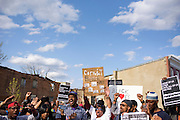 Baltimore, Maryland - April 21, 2015: Several hundred protesters march during a vigil-turned-protest march Tuesday April 21, 2015, in West Baltimore for the death of Freddie Gray who was injured while detained by police, and died from his injuries Sunday. His spinal cord was 80% severed.<br /> <br /> CREDIT: Matt Roth for The New York Times<br /> Assignment ID: 30173645A