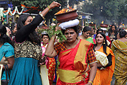 Women carrying clay pots on their heads containing burning camphor oil, in the parade celebrating the festival of Ganesh Chaturthi, marking the birth of the Hindu god Ganesha, on the streets of the La Chapelle area of the 18th arrondissement of Paris, France, on Sunday 1st September 2019. The annual religious festivities and parade take place near the Ganesha Temple of Paris, or Sri Manicka Vinayakar Alayam Temple, the largest Hindu temple in France. Ganesha is the elephant-headed Hindu God of Beginnings, son of Shiva and Parvati, who represents love and knowledge. Picture by Manuel Cohen