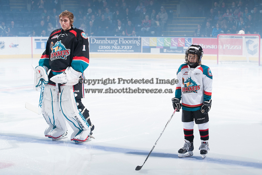KELOWNA, CANADA - OCTOBER 22: Jackson Whistle #1 of the Kelowna Rockets lines up on the ice against the Calgary Hitmen on October 22, 2013 at Prospera Place in Kelowna, British Columbia, Canada.   (Photo by Marissa Baecker/Shoot the Breeze)  ***  Local Caption  ***
