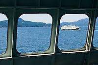 A Washington State ferry seen through the windows of another stste ferry in the San Juan Islands, Washington, USA.