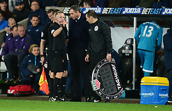Referee Jonathan Moss talks with Swansea City manager Paul Clement as Lukasz Fabianski of Swansea City refuses to be substituted.  - Mandatory by-line: Alex James/JMP - 05/04/2017 - FOOTBALL - Liberty Stadium - Swansea, England - Swansea City v Tottenham Hotspur - Premier League