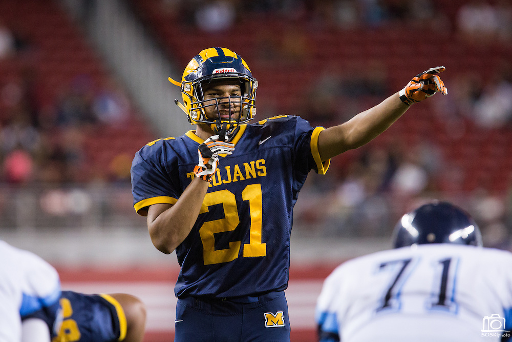 Milpitas defensive back Jarred Green, 21, talks to his team at the line of scrimmage against Valley Christian High School during Friday Night Lights at Levi's Stadium in Santa Clara, California, on September 18, 2015.  Milpitas went on to lose 22-21 against Valley Christian.  (Stan Olszewski/SOSKIphoto)
