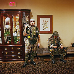 Kyle Green | The Roanoke Times<br /> March 01, 2009 - Craig Barrett (middle, gun raised), from Baltimore, Maryland, and member of the  Bravo Company, 3rd Batallion, 7th Colonial Marines, stands watch in a hallway of the Holiday Inn in Roanoke, Virginia during the 17th annual SheVaCon science fiction and fantasy convention. Bravo Company, 3rd Batallion, 7th Colonial Marines  is the informal name of a group of science fiction costumers in Maryland and Pennsylvania dedicated to celebrating the Colonial Marine characters from James Cameron's 1986 film Aliens.