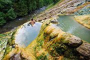 Umpqua Hot Springs, often called Toketee hot springs, in the lush forest above the North Umpqua River, close to the Toketee Lake campground.