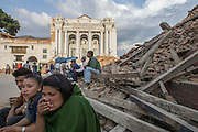 KATHMANDU, NEPAL - APRIL 26: (CHINA OUT)<br /> <br />  Local people and visitors sit on the ruins where used to be Durbar Square on April 26, 2105 in Kathmandu, Nepal. A 8.1-magnitude earthquake struck Nepal on Saturday and the earthquake felt in southeast China\'s Tibet Autonomous Region which brought some houses into collapse. While another 7.1-magnitude earthquake hit the county again the following day afternoon. Chinese government sent out Sichuan Rescue Team, the only one national emergency medical rescue team who could settle camps above an altitude of 3500 meters, to Nepal to support local rescue work and international assistance were also sent to the disaster areas. The earthquake had caused at least 3218 people to death and parts of Chinese visitors were detained in Nepal by Monday morning. <br /> ©Exclusivepix Media
