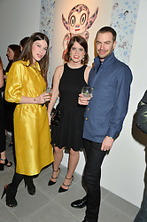 Left to right, LILY LEWIS, PRINCESS EUGENIE OF YORK and ROBERT SHEFFIELD at the Future Contemporaries Party in association with Coach at The Serpentine Sackler Gallery, West Carriage Drive, Kensington Gardens, London on 21st February 2015.
