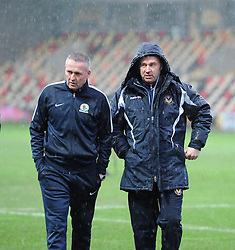 Blackburn Rovers Manager Paul Lambert and Newport County Manager John Sheridan in the rain at Rodney Parade after the referee calls off their FA Cup tie - Mandatory by-line: Paul Knight/JMP - Mobile: 07966 386802 - 09/01/2016 -  FOOTBALL - Rodney Parade - Newport, Wales -  Newport County v Blackburn Rovers - FA Cup third round