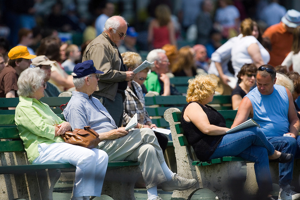 (PPAGE1) Oceanport 5/14/2005  A generous by not jammed packed crowd for opening day at Monmouth Park.   Michael J. Treola Staff Photographer....MJT