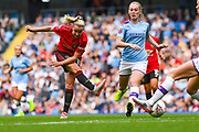 Manchester United Women midfielder Jackie Groenen (14) takes a shot during the FA Women's Super League match between Manchester City Women and Manchester United Women at the Sport City Academy Stadium, Manchester, United Kingdom on 7 September 2019.