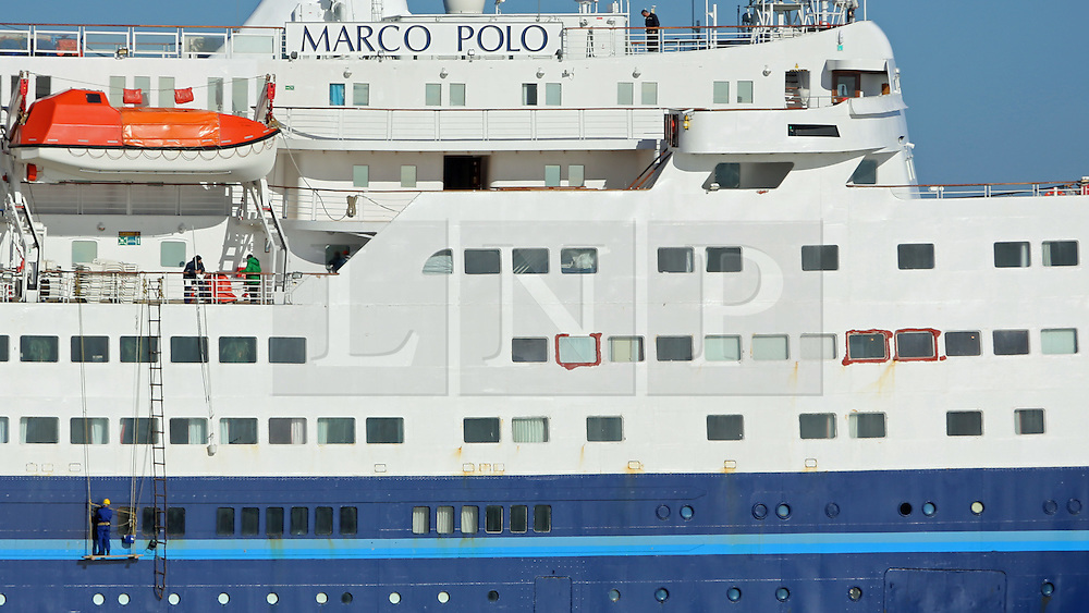 © Licensed to London News Pictures. 16/02/2014. The cruise ship Marco Polo is back at her home port of Tilbury following the death of a passenger in extreme weather. She is due to depart today on her next voyage but work is being done on the ship before she sails later today. Red temporary sealant appears to be visible around the windows damaged by the freak tide. Water surged in to the ship's Waldorf restaurant.  Credit : Rob Powell/LNP