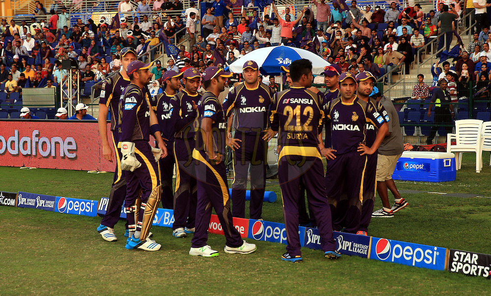 Players of Kolkatta Knight Riders during match 19 of the Pepsi Indian Premier League 2014 Season between The Kolkata Knight Riders and the Rajasthan Royals held at the Sheikh Zayed Stadium, Abu Dhabi, United Arab Emirates on the 29th April 2014<br /> <br /> Photo by Sandeep Shetty / IPL / SPORTZPICS