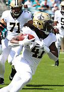 Oct 13, 2019; Jacksonville, FL USA;  New Orleans Saints running back Alvin Kamara (41) runs for yardage during an NFL game against the Jacksonville Jaguars at TIAA Bank Field in Jacksonville, FL. The Saints beat the Jaguars 13-6. (Steve Jacobson/Image of Sport)