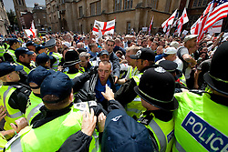 © licensed to London News Pictures. Cambridge, UK  09/07/2011. The English Defence League march in Cambridge. Along the route, EDL supporters clashed with opposition and police. Please see special instructions for usage rates. Photo credit should read Joel Goodman/LNP