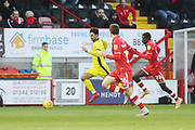 - Conor Thomas gets away from Panutche Camara  during the EFL Sky Bet League 2 match between Crawley Town and Cheltenham Town at the Broadfield Stadium, Crawley, England on 5 January 2019.