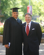 Ole Miss football player Gerald Harris with coach Houston Nutt University of Mississippi graduation ceremonies in the Grove on campus on Saturday, May 8, 2010.